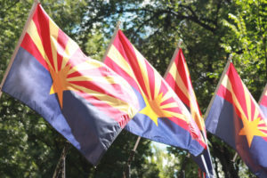 3 Arizona State flags on Capitol courtyard